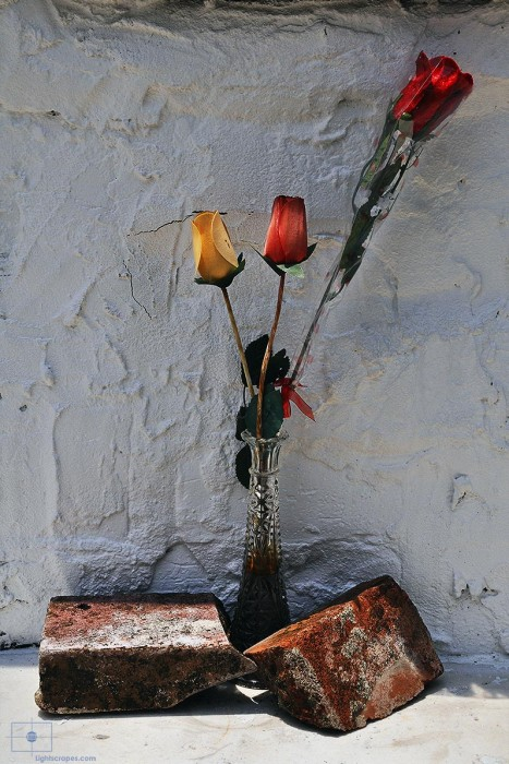 Cloth Roses in Glass Vase with Bricks, St. Louis Cemetery No 1, New Orleans