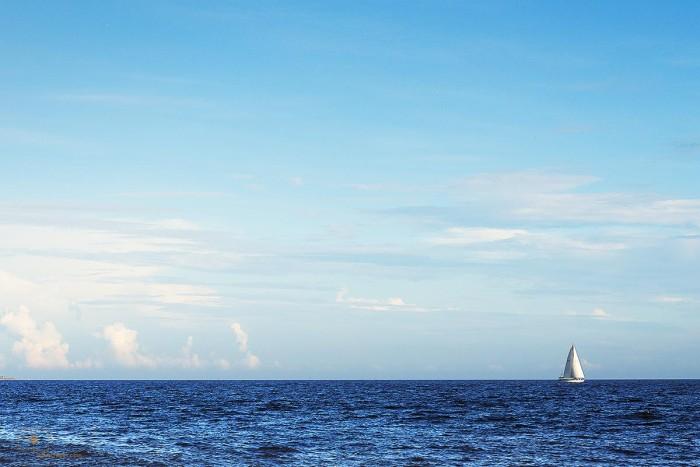 White Sailboat and Clouds at Sunset, Caswell Beach, Oak Island, North Carolina
