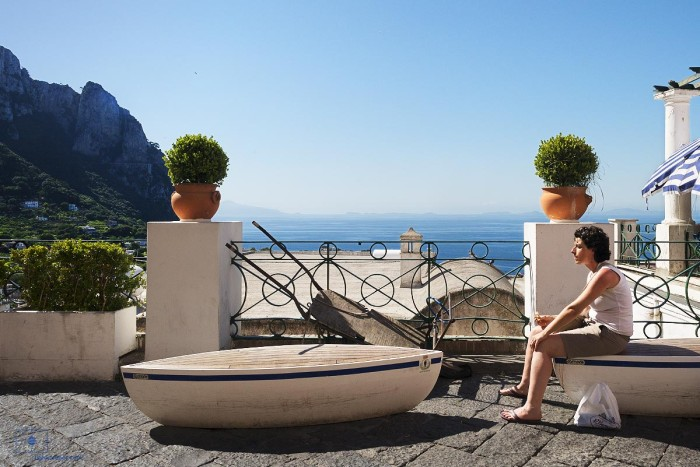 Woman on La Piazzetta with Bay of Naples, Capri, Italy