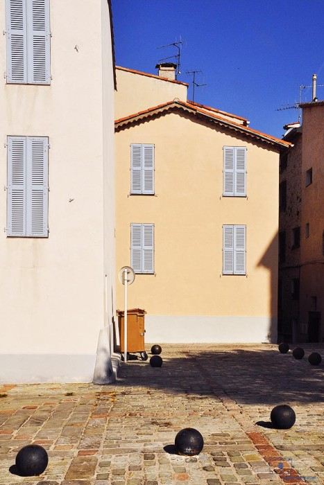 Buildings with Blue Shutters and Cannon Balls at Early Morning, Antibes, France