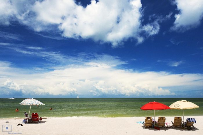 Family on the Beach and Umbrellas, Naples, Florida