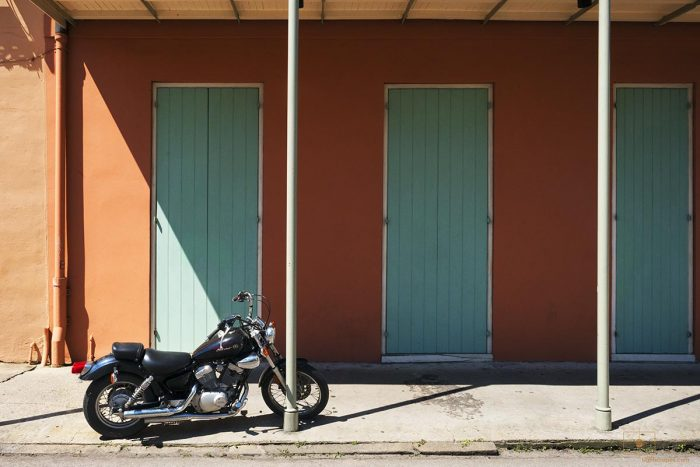 Black Star Motorcycle with Green Doors on Ursulines Avenue, New Orleans