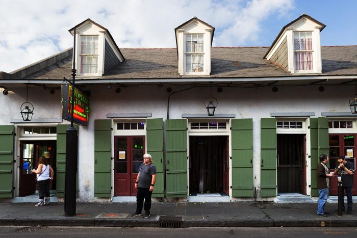 Man Standing Alone and Thinking on Bourbon Street, New Orleans, Louisiana