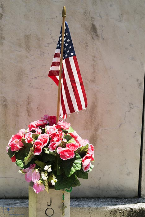 Bouquet of Red and Pink Flowers with an American Flag and Rosary Beads, Lafayette Cemetery No 1, New Orleans