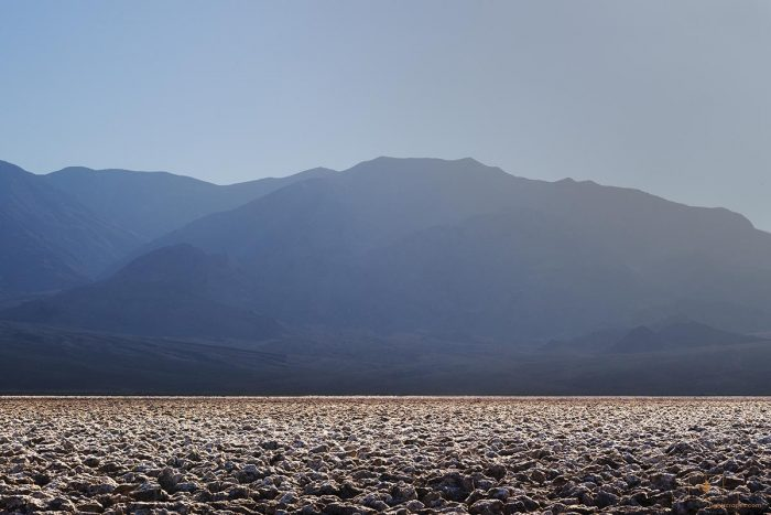 Devil's Golf Course in Sunlight with Panamint Range in Shadow, Death Valley, California