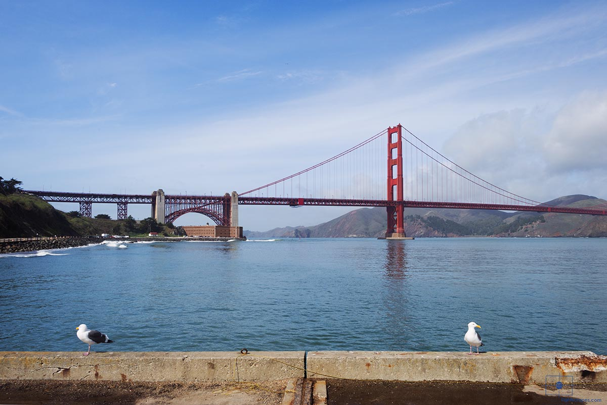 Golden Gate Bridge with San Francisco Bay and Seagulls on Torpedo Wharf, San Francisco, California