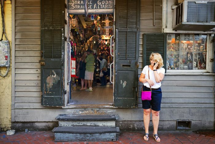 Woman on Phone with Voodoo Shop on Bourbon Street, New Orleans, Louisiana