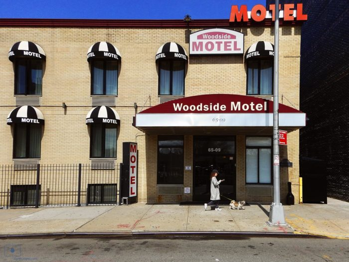 Woman Walking Dog while on Phone at Woodside Motel - Woodside, Queens, New York City