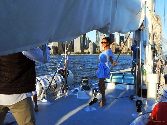 Woman on a Sailboat Posing with the Financial District in the Background - Harbor, New York City